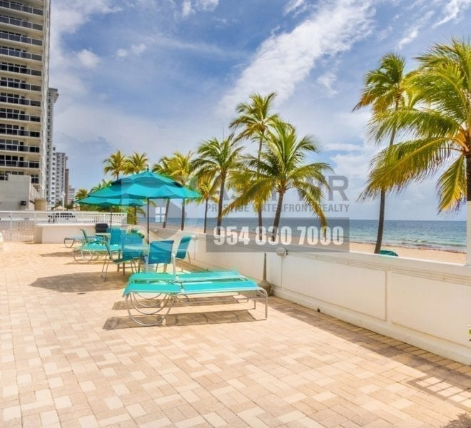 The_Commodore_condominium-3430_Galt_Ocean_Drive_fort_lauderdale_fl_33308-Prestige_Waterfront Realty_askpwr-Pool_Area_Chairs_Umbrellas